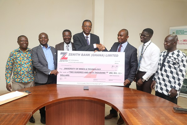 Dr Ofori 3rd from Right Presenting the Dummy Cheque to Prof Kuma 4th from Left