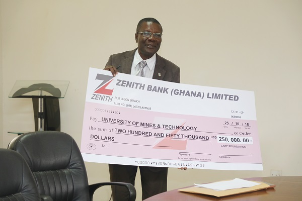 Prof Temeng Showing the Dummy Cheque