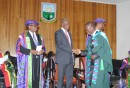 A graduand shaking hands with VP Ammissah- Arthur.jpg
